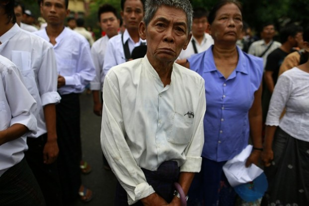 People observe a moment of silence to mark the anniversary of 8888 protests, in Yangon